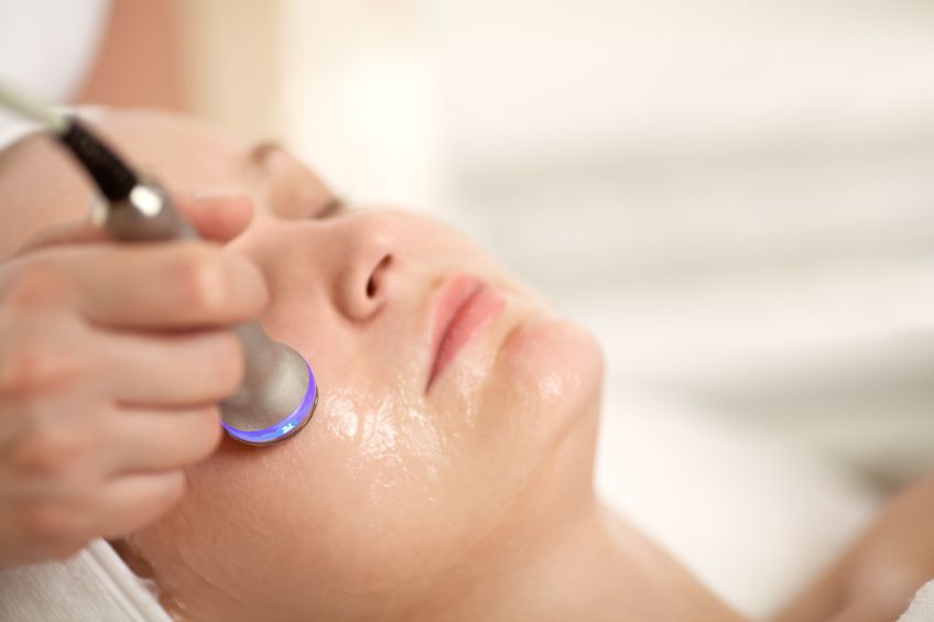 35863818 - close-up shot of woman getting professional facial treatment with special equipment. cosmetician doing lifting procedure
